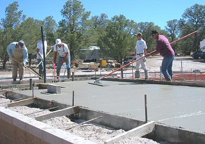Photo of the crew pouring concrete