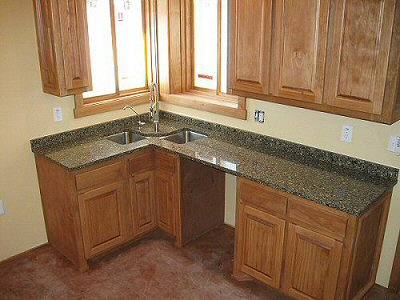 Kitchen with custom cabinets and solid-surface countertops