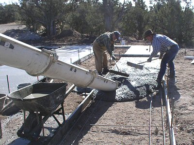 Photo of a crew poring concrete for a manufactured home